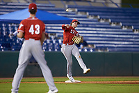 Third baseman Cooper Kinney (57) of Baylor School in Chattanooga, TN playing for the Cincinnati Reds scout team makes a throw to first base during the East Coast Pro Showcase at the Hoover Met Complex on August 2, 2020 in Hoover, AL. (Brian Westerholt/Four Seam Images)