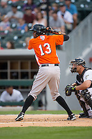 Michael Almanzar (13) of the Norfolk Tides at bat against the Charlotte Knights at BB&T BallPark on April 9, 2015 in Charlotte, North Carolina.  The Knights defeated the Tides 6-3.   (Brian Westerholt/Four Seam Images)