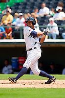 Angel Sanchez (6) of the Charlotte Knights follows through on his swing against the Gwinnett Braves at Knights Stadium on July 28, 2013 in Fort Mill, South Carolina.  The Knights defeated the Braves 6-1.  (Brian Westerholt/Four Seam Images)