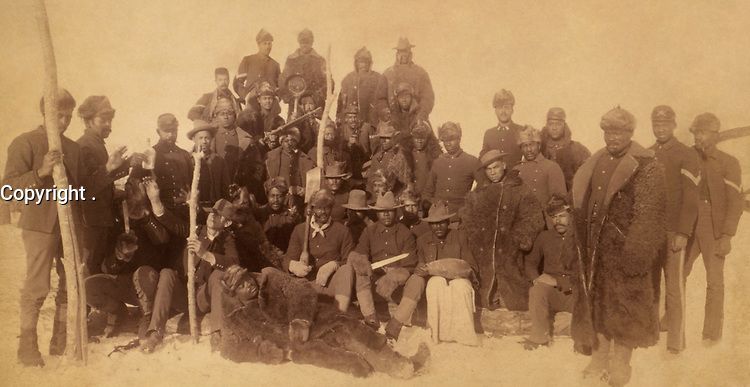 1890- File Photo - Exact  date unknown - Buffalo soldiers of the 25th Infantry, some wearing buffalo robes, Ft. Keogh, Montana -<br /> Restored version of Image:Buffalo soldiers.jpg with artifacts, fibers, and stains removed, rotated, and histogram adjusted.