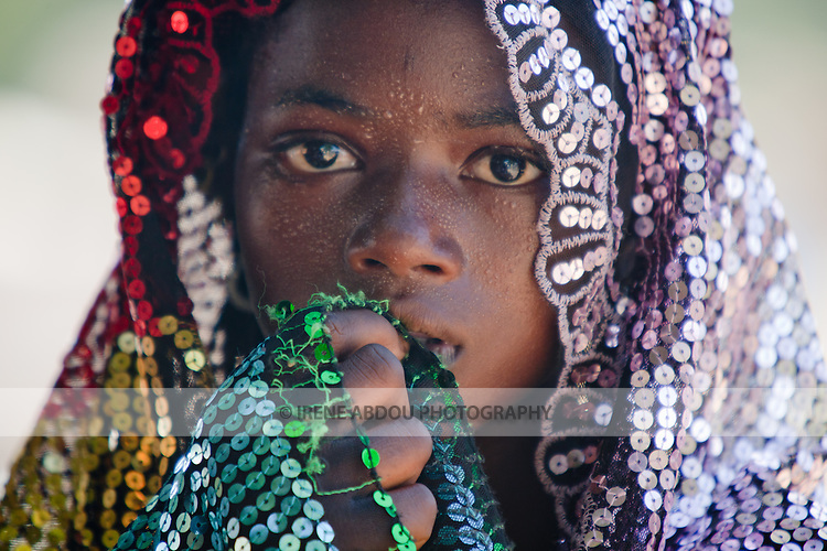 Young Fulani woman In the village market of Bourro in northern Burkina Faso.  The Fulani are traditionally nomadic pastoralists, crisscrossing the Sahel season after season in search of fresh water and green pastures for their cattle and other livestock.
