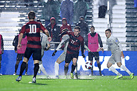CARY, NC - DECEMBER 13: Gabe Segal #17 of Stanford University slips while chasing the ball on the rain soaked field during a game between Stanford and Georgetown at Sahlen's Stadium at WakeMed Soccer Park on December 13, 2019 in Cary, North Carolina.