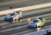 Sept. 14, 2012; Concord, NC, USA: NHRA funny car driver Jack Beckman (right) races alongside Mike Neff during qualifying for the O'Reilly Auto Parts Nationals at zMax Dragway. Mandatory Credit: Mark J. Rebilas-