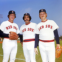 Boston Red Sox pitchers Rick Wise (40), Juan Marichal (21), and Reggie Cleveland (26) poses for a photo during Spring Training circa 1974 at Chain of Lakes Park in Winter Haven, Florida.  (Brearley Collection/Four Seam Images)