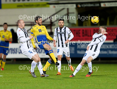 Dunfermline v St Johnstone…15.12.20   East End Park      BetFred Cup<br />Murray Davidson wins the ball despite the efforts of Kerr McInroy, Ryan Dow and Kyle Turner<br />Picture by Graeme Hart.<br />Copyright Perthshire Picture Agency<br />Tel: 01738 623350  Mobile: 07990 594431