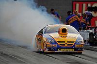 Oct. 31, 2008; Las Vegas, NV, USA: NHRA pro stock driver Rickie Jones does a burnout during qualifying for the Las Vegas Nationals at The Strip in Las Vegas. Mandatory Credit: Mark J. Rebilas-