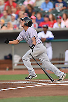 Jacksonville Suns third baseman Austin Barnes #16 swings at a pitch during a game against the Tennessee Smokies at Smokies Park July 10, 2014 in Kodak, Tennessee. The Suns defeated the Smokies 6-5. (Tony Farlow/Four Seam Images)
