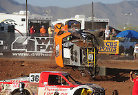 Apr 17, 2011; Surprise, AZ USA; LOORRS driver Phil Bollman (65) flips over during round 4 at Speedworld Off Road Park. Mandatory Credit: Mark J. Rebilas-