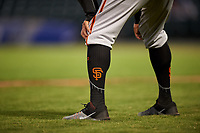 A detailed view of AZL Giants Orange manager Alvaro Espinoza's (99) San Francisco Giants Stance socks during an Arizona League game against the AZL Cubs 1 on July 10, 2019 at Sloan Park in Mesa, Arizona. The AZL Giants Orange defeated the AZL Cubs 1 13-8. (Zachary Lucy/Four Seam Images)