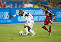 13 August 2011: Real Salt Lake defender Chris Wingert #17 and Toronto FC Eric Avila #8 in action during a game between Real Salt Lake and Toronto FC at BMO Field in Toronto..Toronto FC won 1-0.