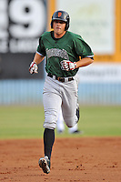 Augusta GreenJackets left fielder Andrew Cain #36 rounds the bases after homering in the third inning during a game against the Asheville Tourists at McCormick Field on June 27, 2013 in Asheville, North Carolina. The Tourists won the game 10-6. (Tony Farlow/Four Seam Images)