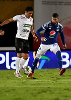 BOGOTA - COLOMBIA, 27-11-2020: Matias de los Santos de Millonarios F. C. y Roberto Ovelar de Once Caldas disputan el balon, durante partido entre Millonarios F. C. y Once Caldas de la fecha 1 por la Liguilla BetPlay DIMAYOR 2020 jugado en el estadio Nemesio Camacho El Campin de la ciudad de Bogota. / Matias de los Santos of Millonarios F. C. and Roberto Ovelar of Once Caldas figth for the ball, during a match between Millonarios F. C. and Once Caldas of the 1st date for the BetPlay DIMAYOR 2020 Liguilla played at the Nemesio Camacho El Campin Stadium in Bogota city. / Photo: VizzorImage / Luis Ramirez / Staff.