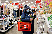 NEW YORK, NEW YORK - MARCH 02: A woman buy flowers at Target store on March 02, 2021 in New York. Target hopes to build a growth by investing about $ 4 billion annually for the next years to accelerate the consolidation of new stores, upgrade existing ones and enhance its capacity to fulfill online orders. (Photo by Emaz/VIEWpress)
