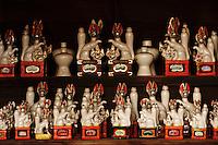 Fox statues at an Inari Shrine, Shimosuwa, Japan.