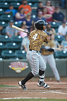 Andretty Cordero (4) of the Down East Wood Ducks follows through on his swing against the Winston-Salem Dash at BB&T Ballpark on May 12, 2018 in Winston-Salem, North Carolina. The Wood Ducks defeated the Dash 7-5. (Brian Westerholt/Four Seam Images)