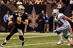 December 2009: New Orleans Saints quarterback Drew Brees (9) runs out of the pocket during an NFL football game at the Louisiana Superdome in New Orleans.  The Cowboys defeated the Saints 24-17.