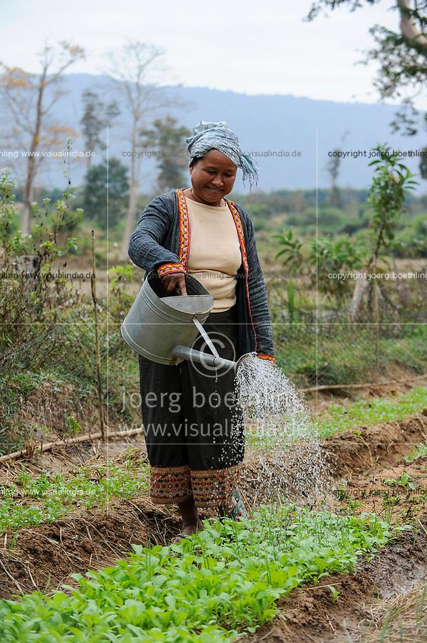 Laos, District Sang Thong,  woman cultivates vegetable field  / Laos, Farmerin baut Gemuese an, Bewaesserung mit Giesskanne