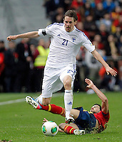 Spain's Sergio Busquets (r) and Finland's Hamalainen during international match of the qualifiers for the FIFA World Cup Brazil 2014.March 22,2013.(ALTERPHOTOS/Victor Blanco)