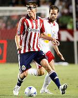 Chivas USA forward, Justin Braun(17) looks for options up the field while NY Red Bulls defender, Kevin Goldthwaite(2) chases from behind during the 1st half. Chivas USA  took on the NY Red Bulls on June 28, 2008 at the Home Depot Center in Carson, CA. The game ended in a 1-1 tie.