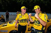 Jun 17, 2018; Bristol, TN, USA; NHRA pro stock driver Jeg Coughlin Jr (right) celebrates with father Jeg Coughlin Sr after winning the Thunder Valley Nationals at Bristol Dragway. Mandatory Credit: Mark J. Rebilas-USA TODAY Sports