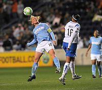 April 25, 2009 Boston Breakers vs. Chicago Red Stars--#18 Frida Ostberg of the Chicago Reds Stars wins a header against #16 Angela Hucles.  Red Stars win the match 4-0.