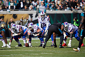 Buffalo Bills quarterback Tyrod Taylor (5) under center Eric Wood (70) during an NFL Wild-Card football game against the Jacksonville Jaguars, Sunday, January 7, 2018, in Jacksonville, Fla.  (Mike Janes Photography)