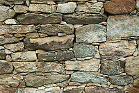 Stone wall made from fitting rocks together in drystone fashion
