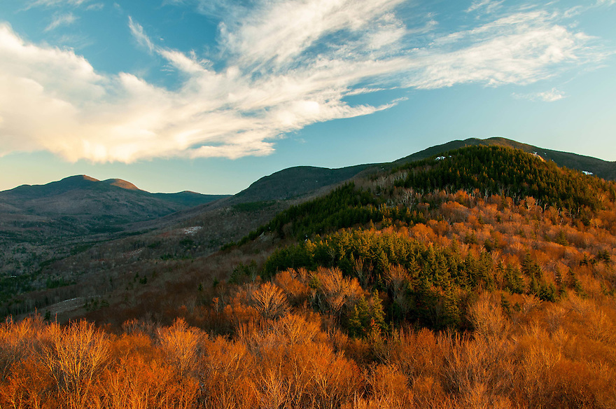 Late day light warms a chilly spring landscape in this view to Mt. Tom and Mt. Field.