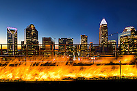Charlotte Skyline Photography -  <br /> <br /> Dinners visiting Fahrenheit Restaurant Charlotte, get to enjoy the warmth of the long gas powered fire pits while taking in the beautiful views from the 21st floor of uptown Charlotte North Carolina from the rooftop restaurant. <br /> <br /> Charlotte Photographer - PatrickSchneiderPhoto.com