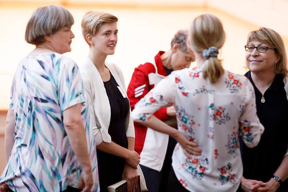 Volunteer Chelsea Balmer speaks with audience members during Stage III at the 11th USA International Harp Competition at Indiana University in Bloomington, Indiana on Wednesday, July 10, 2019. (Photo by James Brosher)