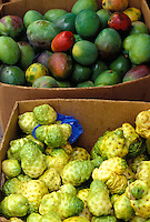 Mangoes and noni fruit on display at a Chinatown food market, Honolulu