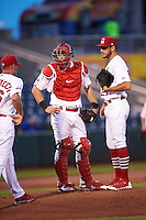 Springfield Cardinals starting pitcher Daniel Poncedeleon (23) and catcher Carson Kelly (5) look to pitching coach Jason Simontacchi (46) for a mound meeting during a game against the Northwest Arkansas Naturals on April 26, 2016 at Hammons Field in Springfield, Missouri.  Northwest Arkansas defeated Springfield 5-2.  (Mike Janes/Four Seam Images)