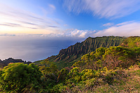 The soft light of a sunset and moving clouds highlight Kalalau Valley, as seen from the famous Kalalau Lookout in Koke'e State Park, Kaua'i.