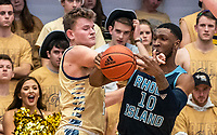 WASHINGTON, DC - FEBRUARY 8: Cyril Langevine #10 of Rhode Island and Chase Paar #3 of George Washington clash during a game between Rhode Island and George Washington at Charles E Smith Center on February 8, 2020 in Washington, DC.