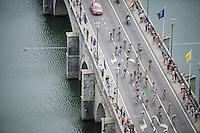 peloton crossing the Meuse river<br /> <br /> stage 4: Seraing (BEL) - Cambrai (FR) <br /> 2015 Tour de France