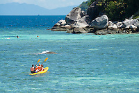 Family with two kids kayaking in Andaman sea, Ko Lipe, Thailand