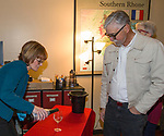 """Rebecca Davidson pours wine for Richard Breitling during the Reno Magazine """"Bubbles Tasting"""" event at Total Wine in Reno on Friday night, February 9, 2018."""