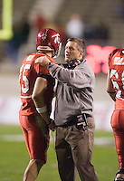 23 December 2006: Utah head coach Kyle Whittingham congratulates quarterback Brent Ratliff after a late touchdown during the 2006 Bell Helicopters Armed Forces Bowl between The University of Tulsa and The University of Utah at Amon G. Carter Stadium in Fort Worth, TX.