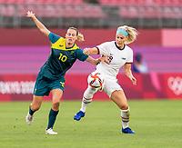 KASHIMA, JAPAN - JULY 27: Emily van Egmond #10 of Australia fights for the ball with Julie Ertz #8 of the USWNT during a game between Australia and USWNT at Ibaraki Kashima Stadium on July 27, 2021 in Kashima, Japan.