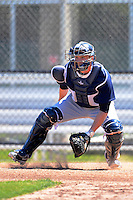 New York Yankees catcher Nick McCoy #13 during warmups before a minor league Spring Training game against the Philadelphia Phillies at Carpenter Complex on March 21, 2013 in Clearwater, Florida.  (Mike Janes/Four Seam Images)