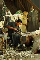 Wood carver of religious icons at work. Patzcuaro Michoacan Mexico.