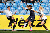 US's Tobin Heath fights for the ball with Germany's Anja Mittag during their Algarve Women's Cup soccer match at Algarve stadium in Faro, March 13, 2013.  .Paulo Cordeiro/ISI