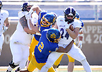 BROOKINGS, SD - APRIL 24: Holy Cross Crusaders running back Peter Oliver #24 lis brought down by South Dakota State Jackrabbits safety Isaiah Stalbird #2 at Dana J Dykhouse Stadium on April 24, 2021 in Brookings, South Dakota. (Photo by Dave Eggen/Inertia)