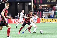 ATLANTA, GA - MARCH 07: ATLANTA, GA - MARCH 07: Atlanta United midfielder Ezequiel Barco dribbles the ball against Frankie Amaya during the match against FC Cincinnati, which Atlanta won, 2-1, in front of a crowd of 69,301 at Mercedes-Benz Stadium during a game between FC Cincinnati and Atlanta United FC at Mercedes-Benz Stadium on March 07, 2020 in Atlanta, Georgia.