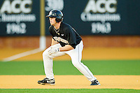 Jack Carey #20 of the Wake Forest Demon Deacons takes his lead off of second base against the Miami Hurricanes at Gene Hooks Field on March 18, 2011 in Winston-Salem, North Carolina.  Photo by Brian Westerholt / Four Seam Images