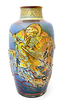 BNPS.co.uk (01202) 558833. <br /> Pic: Kinghams/BNPS<br /> <br /> A 'holy grail' 112-year-old vase has set a new world record when it sold at auction for £92,000.<br /> <br /> The St George vase made by Pilkington Royal Lancastrian is one of only two known examples in existence and this was only the second time in its history it has been sold.<br /> <br /> The incredibly rare piece of pottery was bought by prominent Victorian and Edwardian pottery collector Anthony Cross at auction in the late 1970s. Before that it had been owned by someone who knew the Pilkington family.