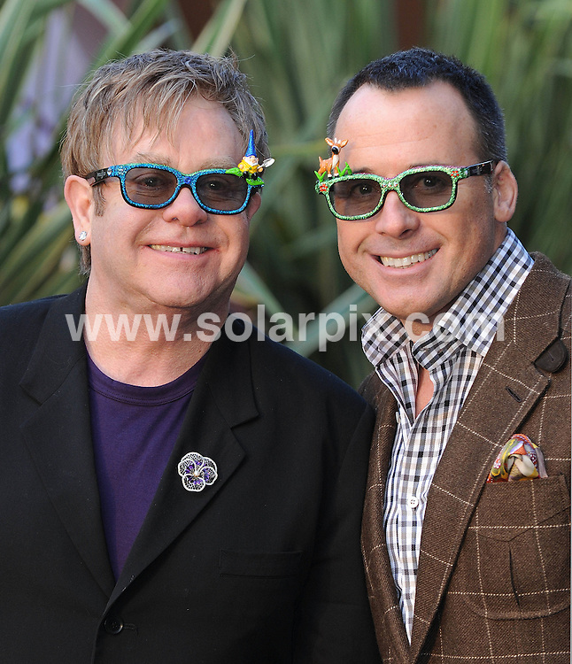 **ALL ROUND PICTURES FROM SOLARPIX.COM**                                             **WORLDWIDE SYNDICATION RIGHTS**                                                                                  Caption: UK film premiere of Gnomeo and Juliet at Odeon Leicester Square  in London Uk                                                                             .. This pic: Elton John & David Furnish                                                                                             JOB REF: 12731      SSD       DATE:  30.01.2011                                                          **MUST CREDIT SOLARPIX.COM OR DOUBLE FEE WILL BE CHARGED**                                                                      **MUST AGREE FEE BEFORE ONLINE USAGE**                               **CALL US ON: +34 952 811 768 or LOW RATE FROM UK 0844 617 7637**