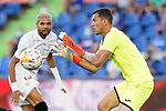 Getafe CF's David Soria (r) and Sevilla FC's Youssef En-Nesyri during La Liga match. August 23,2021. (ALTERPHOTOS/Acero)