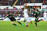 Jordan Ayew of Swansea City is marked by Harry Arter of Bournemouth during the Premier League match between Swansea City and Bournemouth at the Liberty Stadium, Swansea, Wales, UK. Saturday 25 November 2017