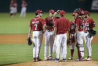 Arkansas head coach Dave Van Horn talks to relief pitcher Kevin Kopps (45), Saturday, June 5, 2021 during the sixth inning in the second game of the NCAA Fayetteville Regional at Baum-Walker Stadium in Fayetteville. Check out nwaonline.com/210606Daily/ for today's photo gallery. <br /> (NWA Democrat-Gazette/Charlie Kaijo)